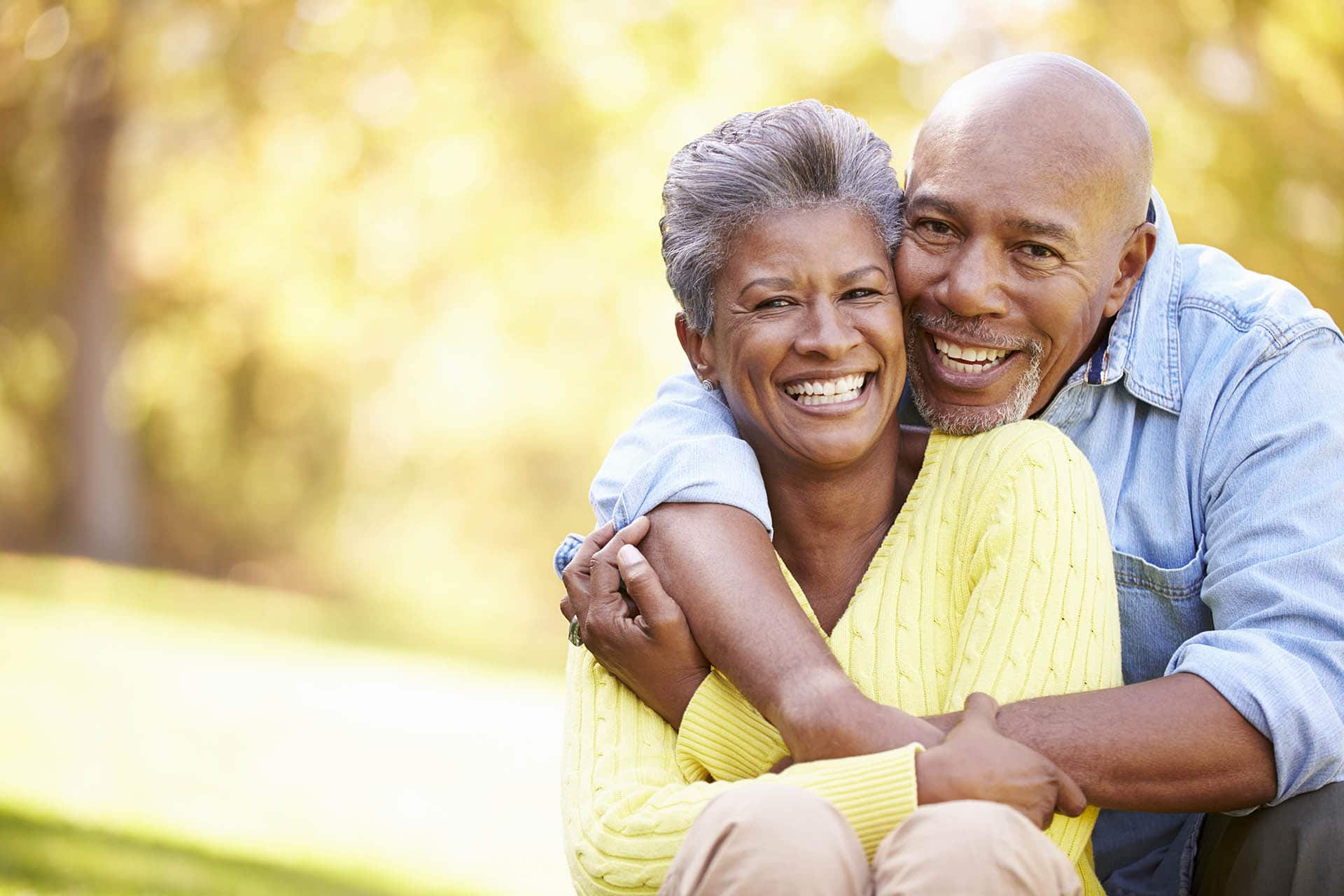 couple hugging after receiving reverse mortgage counseling