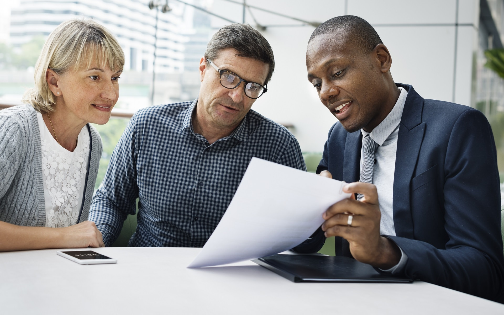 couple looking over reverse mortgage limits with a loan officer