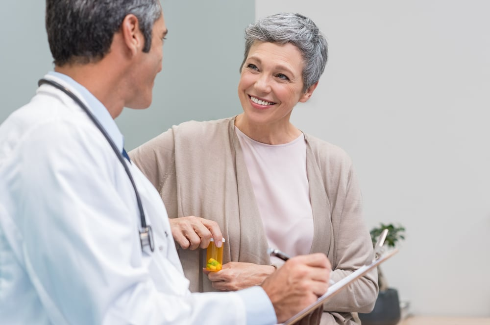 woman discussing her prescriptions with her doctor