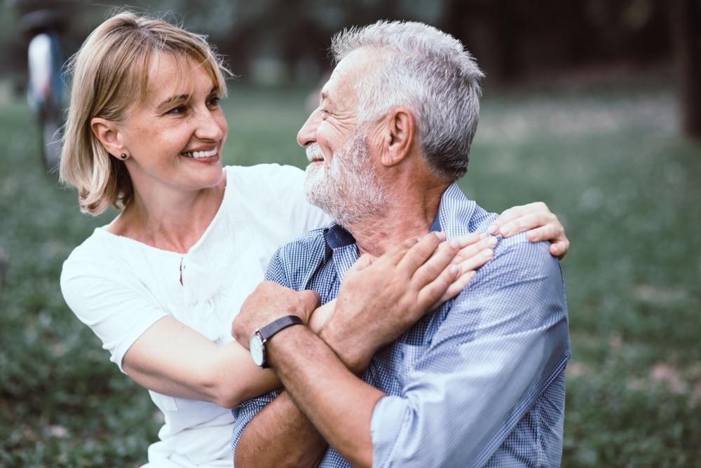 couple smiling at each other after receiving a reverse mortgage